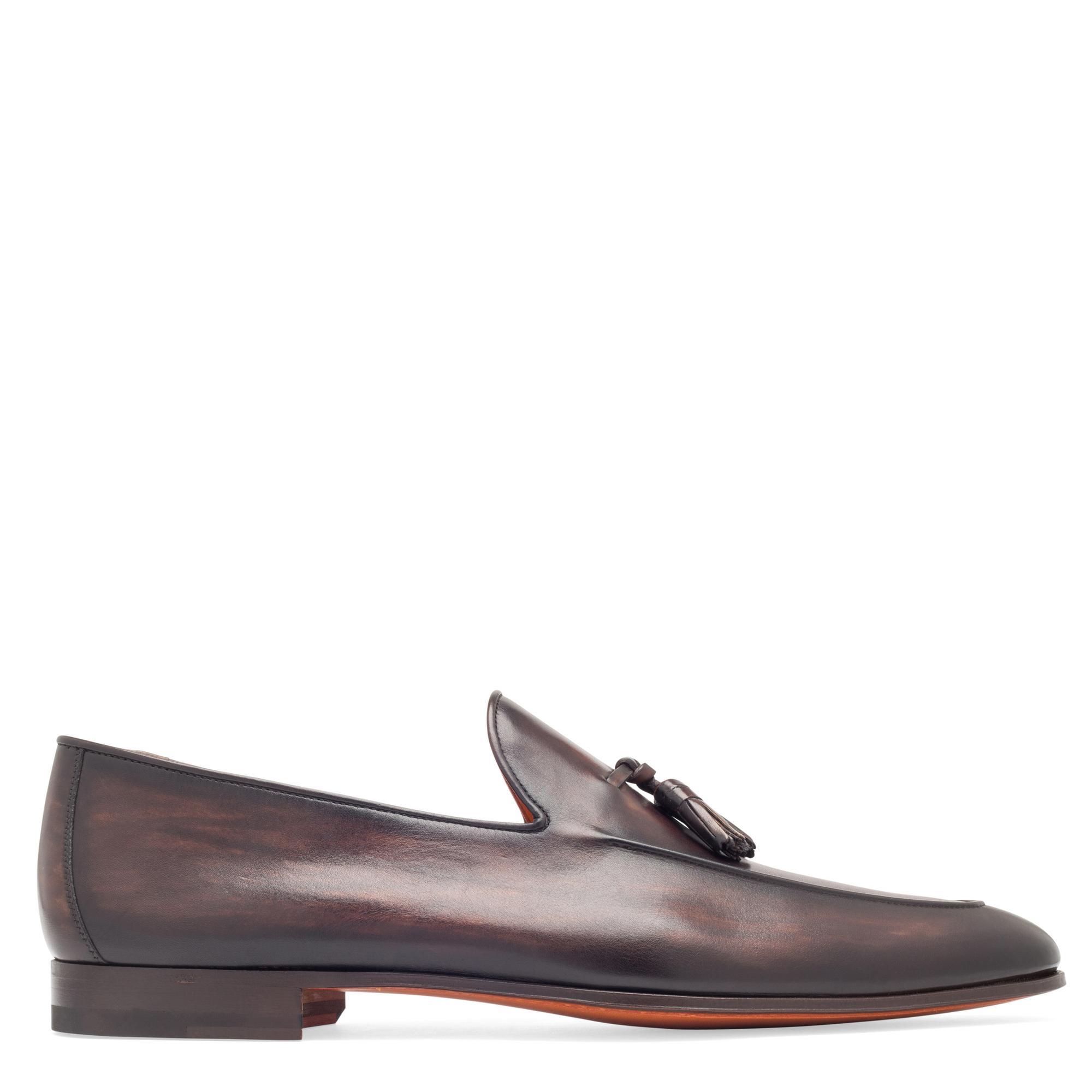 حذاء جلدي مسطح مزيّن بأربطة متدلية